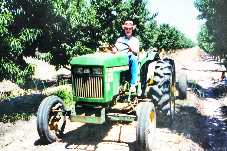 Mark working on the farm in high school