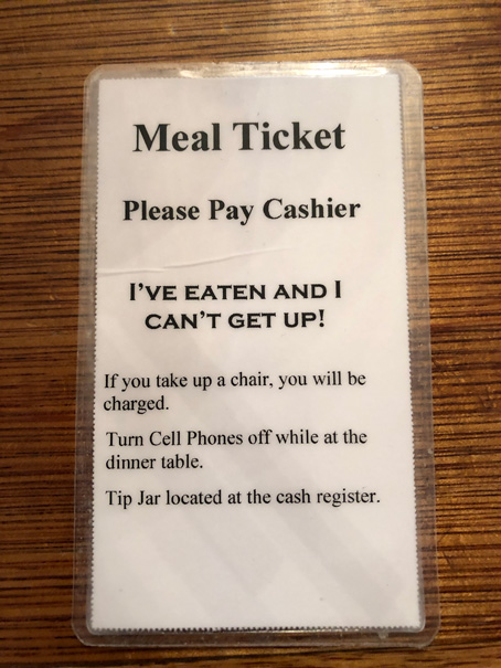 Meal ticket.  Be sure to put your cell phone away otherwise they will tell you to do so!